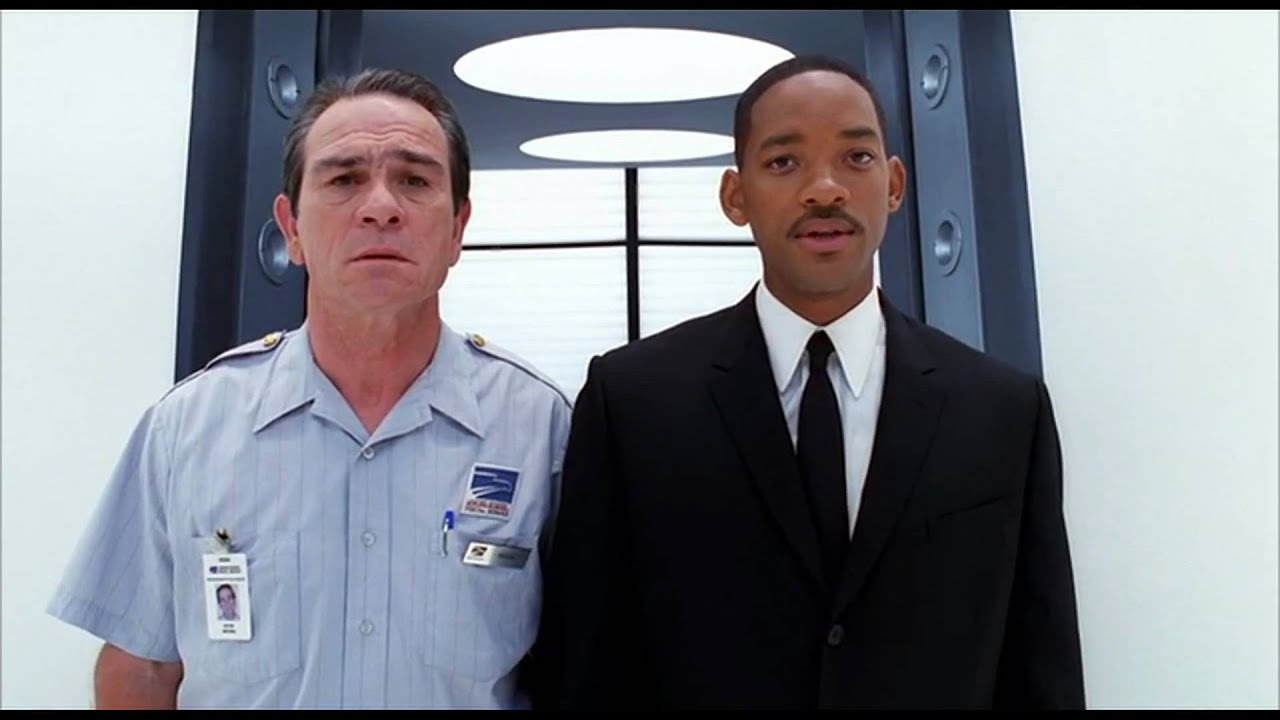 men in black 2 agent J and K in mailman uniform